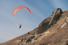 Paraglider flying over mountains Royalty Free Stock Photos