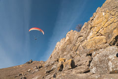 Paraglider flying over mountains Royalty Free Stock Images