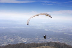 Paraglider flying Stock Photography