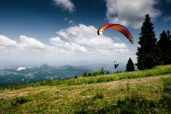 Paraglider. Flying over the Romanian mountains Royalty Free Stock Photography