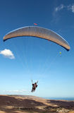 Paraglider flying in the sky Stock Images