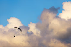 Paraglider flying on sky Royalty Free Stock Photo