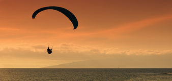 Paraglider flying at sunset Royalty Free Stock Images