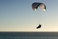 Paraglider flying at sunset Royalty Free Stock Photography