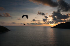 Paraglider flying at the sunset time at the shore Stock Images