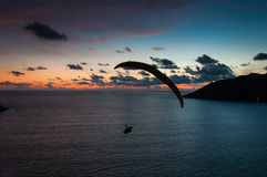 Paraglider flying at the sunset time at the shore Stock Image