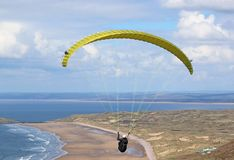 Paraglider flying at Rhosilli royalty free stock images
