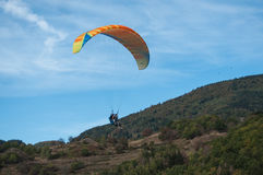 Paraglider  going to land in a field Royalty Free Stock Photography
