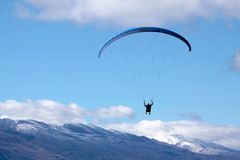 Paraglider In The Mountains Stock Photo