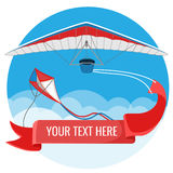 Paraglider and kite with red advertising banner flying in blue sky background Stock Photos