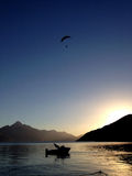 Paraglider, lake and sunset Stock Photos