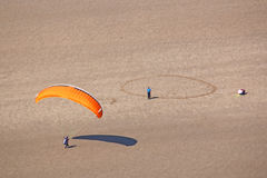 Paraglider landing on the beach Royalty Free Stock Images
