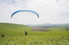 Paraglider lata above pole Obraz Stock