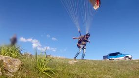 Paraglider launching from the ridge stock video