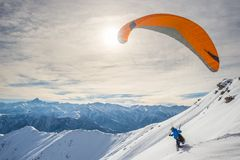 Paraglider launching from snowy slope Royalty Free Stock Photography