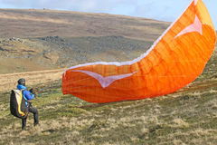 Paraglider launching wing. Paraglider doing a reverse launch on Dartmoor Royalty Free Stock Photos
