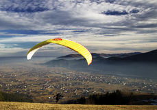 Paraglider launching wing. Over Romanian village Stock Images