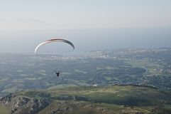 Paraglider man above Atlantic coast Stock Photo