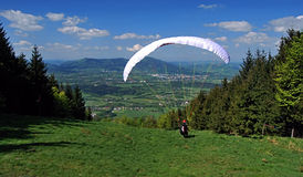 Paraglider on meadow near Skalka hill. In Podbeskydska pahorkatina mountains with nice mountains panorama Stock Image
