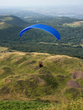 Paraglider in midair. Over countryside, Auvergne, France Stock Photography