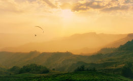 Paraglider in the misty valley Royalty Free Stock Image