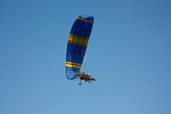 Paraglider with a motor in  sky Stock Image