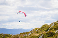 Paraglider on Mount Ulriken. Gliding down Mount Ulriken in Bergen Royalty Free Stock Photos