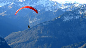 Paraglider in the mountain. Paraglider in the air, flight through the mountains Stock Images