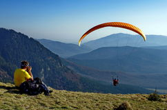 Paraglider over the Ciucas Mountains, landmark attraction in Romania Stock Photography