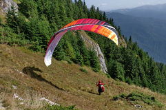 Paraglider ready to jump - Postavaru Mountains, landmark attraction in Romania Royalty Free Stock Photography