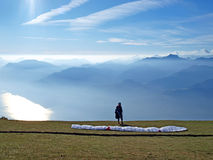 Paraglider in the mountains. Picture of the paraglider in the mountains Royalty Free Stock Photo