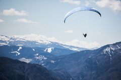 Paraglider in mountains Stock Images