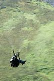 Paraglider moving down Royalty Free Stock Images