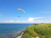 Free Paraglider Near Cliff Along Baltic Sea Coastline Stock Image - 136635781