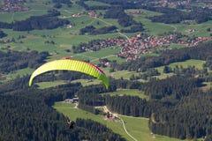 Paraglider over bavarian village Stock Image