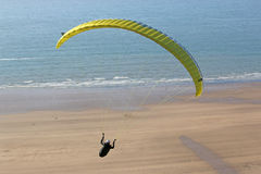 Paraglider over the beach Stock Photo