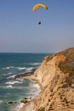 Paraglider over a cliff Stock Photo