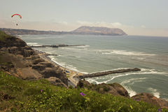 Paraglider over cliffs on Lima's coastline Royalty Free Stock Photography