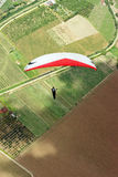 A paraglider over Colombian fields Royalty Free Stock Images