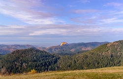 PARAGLIDER OVER FARMED LAND BEAUTIFUL SUNSET LIGHT, SEEN FROM AIR Stock Image