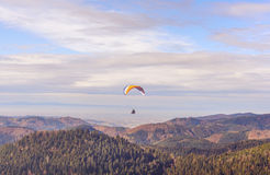 PARAGLIDER OVER FARMED LAND BEAUTIFUL SUNSET LIGHT, SEEN FROM AIR Royalty Free Stock Image