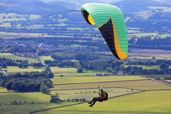 Paraglider over fields Royalty Free Stock Photo