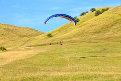 Paraglider over the green valley Royalty Free Stock Photos