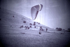 Paraglider over the green valley. Old photo. Stock Photo