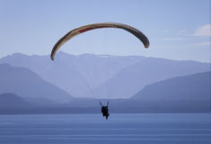 Paraglider over lake royalty free stock photo