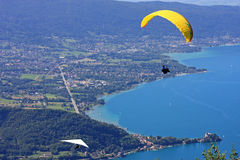 Paraglider over Lake Annecy Stock Images