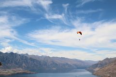Paraglider over lake Wakatipu Queenstown with the remarkables in the background. Para-glider over lake Wakatipu Queenstown with the remarkables mountains in the Royalty Free Stock Images