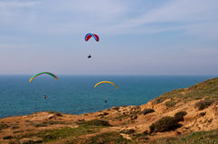 Paraglider over Mediterranean sea . Parachute flying above the sea . Israel stock image
