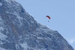 Paraglider over mountain Stock Photos