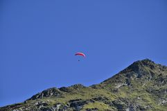 Paraglider over the mountains Royalty Free Stock Images